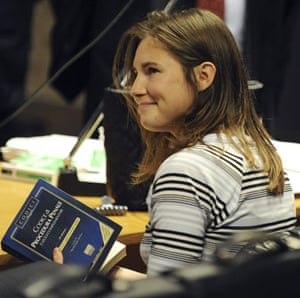 Gallery Meredith Kercher trial: Murder suspect Amanda Knox holds the Italian penal code book at her trial