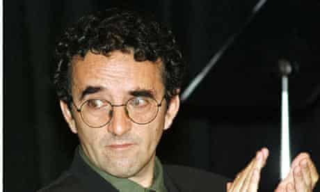 Chilean-born writer Roberto Bolano applauds during a ceremony