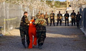 US Army Military Police escorting detainee, Guantanamo Bay, 2002