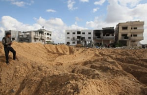 Gallery Gaza then and now: Beit Lahia, Gaza Strip: A Palestinian boy stands on a mound of dirt