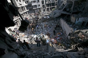 Gallery Gaza then and now: Al Sheikh Redwan area, Gaza City: Palestinians inspect the rubble