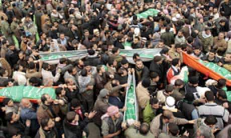Palestinians carry bodies of Hamas leader Rayyan