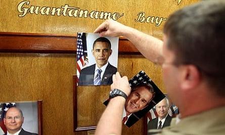 An image of President Barack Obama is put up at Guantanamo Bay.