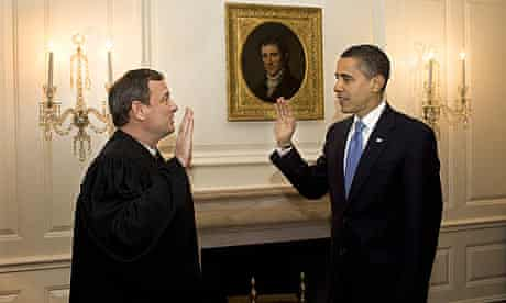 Barack Obama retakes the oath of office in the map room of the White House