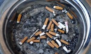 Cigarette butts in the designated smoking area outside Mecca Bingo, Acocks Green, Birmingham.