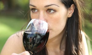Young woman drinking a glass of red wine Young woman drinking a glass of red wine