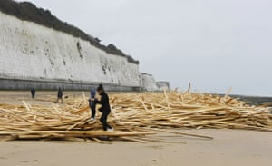 Gallery Timber galore: Local Ramsgate residents play on timber washed up on the beach