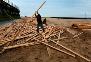 Gallery planks in Ramsgate: Locals collecting wood that was washed up on Ramsgate beach