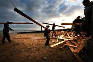Gallery planks in Ramsgate: Locals collecting planks that were washed up on Ramsgate beach