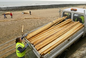 Gallery planks in Ramsgate: A man salvages a cargo of timber lost from the ship Sinegorsk