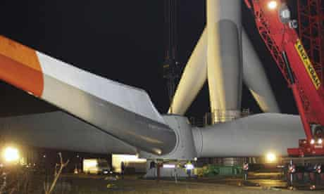 Workers install a wind turbine produced by Multibrid