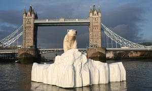 A 16 foot-high sculpture of a female polar bear and cub floating down the Thames