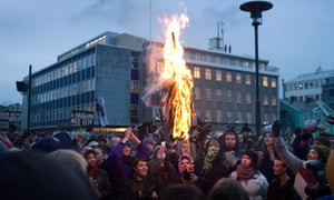 Protesters burn an effigy in Reykjavik
