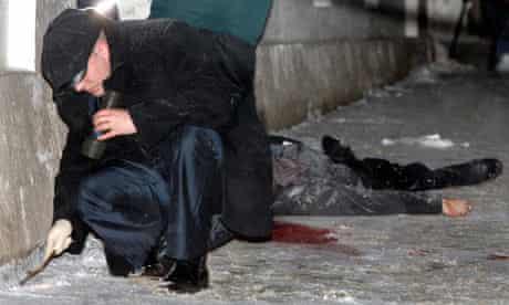An investigator works near the body of slain lawyer Stanislav Markelov