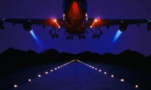 Jet aeroplane taking off at night