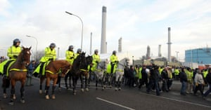 Gallery Oil refineries strike: Police watch protesters outside the Total Lindsey oil refinery.