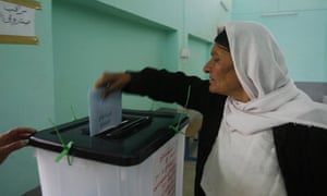 A woman casts her vote at a polling station in Sinjar