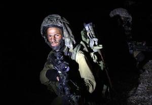 Gallery Israeli troops enter Gaza: Israeli soldiers advance near the border