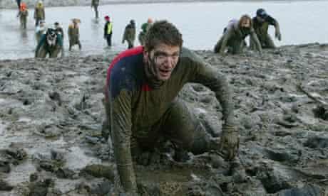 Matthew Weaver struggles through the mud of the River Blackwater in Maldon, Essex