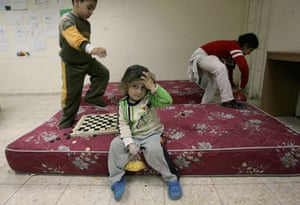 Gallery gaza conflict: Children play inside a bomb shelter in the  Israeli town of Sderot