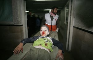 Gallery gaza conflict: Palestinian medics carry a wounded boy into a hospital in Gaza City