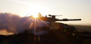 Gallery gaza conflict:  An Israeli tank patrols along the Israeli border with the Gaza Strip