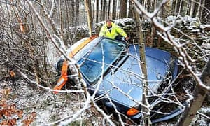 A car is pulled from a ditch after crashing in snow in Northumberland
