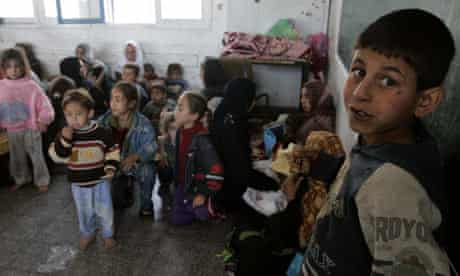 Palestinians who fled their homes from Israeli forces' operations gather in an UNRWA school building