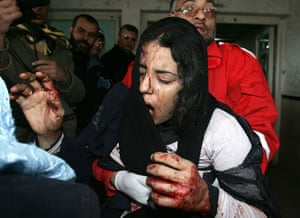 Gallery Gaza: 4 January: A wounded Palestinian girl is carried into a hospital in Gaza