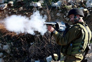 Gallery Gaza: Israeli soldier fires tear gas during clashes with Palestinian protesters