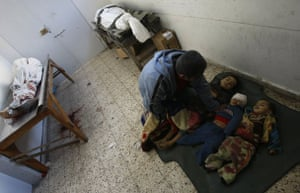 Gallery Gaza: Palestinian father Magdi al-Samuli mourns over the bodies of his children