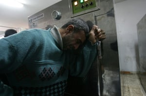 Gallery Gaza: A relative of a Palestinian victim cries at the morgue