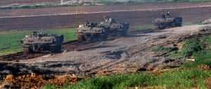Gallery Gaza: A line of Israeli armoured personnel carriers (APCs)