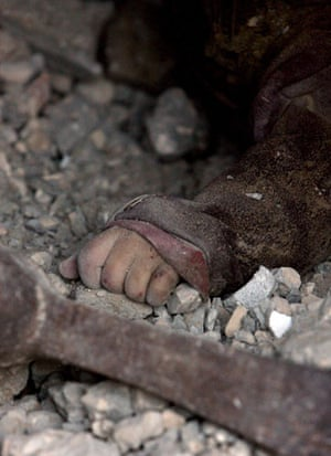 Gallery gaza: The hand of a girl  in the rubble of her destroyed house in Gaza City