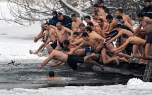 Gallery Eyewitness: Bulgarians jump into a lake in Sofia to mark the Feat of the Epiphany