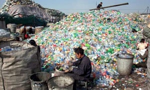 Migrant workers sort the plastic waste for recycling