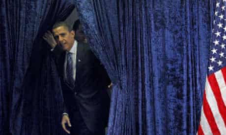 U.S. President-elect Obama steps out from behind a curtain