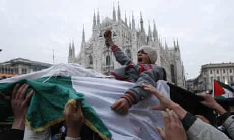 Demonstrators protest against  Israeli airstrikes in Gaza in front of Milan cathedral