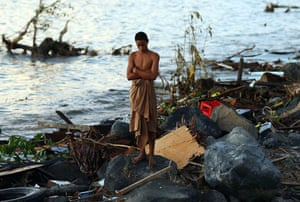 Samoa: A man looks at the debris at the waterfront in Lalomanu
