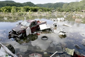Samoa: A destroyed truck along with other debris in a lagoon