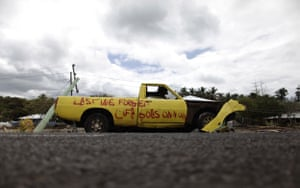 Samoa: Fresh graffiti adorns a tsunami-damaged vehicle