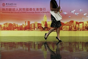 Week in Business: Billboard featuring the China RMB Sovereign Bonds in Hong Kong.