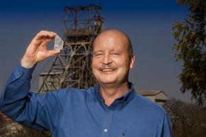 Week in Business: Johan Dippenaar, Petra Diamonds chief executive,  holds the white diamond.