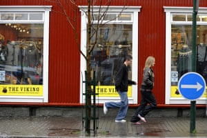 Week in Business: Teenagers run in front of a store in Reykjavik centre.