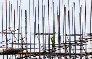 Week in Business: A scaffolder at work on a building site.