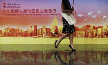 A billboard featuring the China RMB Sovereign Bonds at Bank of China Tower in Hong Kong.