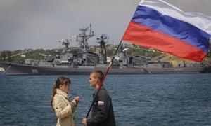 Man holding a Russian flag at the Crimean Peninsula port of Sevastopol, Ukraine, May 11, 2008