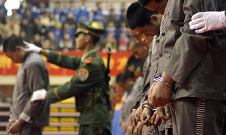 Hardcore convicts at a sentencing rally in the east Chinese city of Wenzhou, 7 April 2004