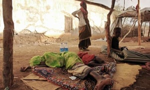 Woman and child suffering from Acute Water Diarrhea, Wanleweyn district, Somalia, April 5, 2009