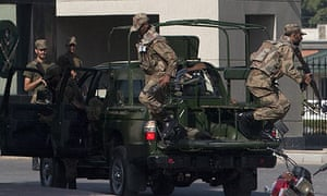 Armed soldiers take their positions at the gates of Pakistan's army headquarters in Rawalpindi
